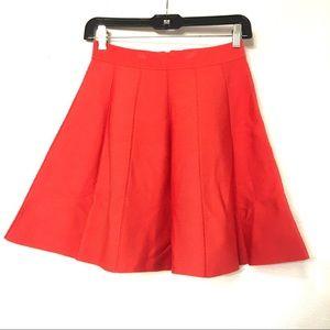 Parker Orange pleated skirt.